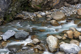 Water flowing at a river — ストック写真