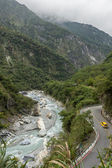 Landscape of steep mountains, river and a road at the Taroko National Park — ストック写真