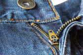 Close-up of unzipped and unbuttoned blue jeans — Stock Photo