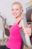 Woman in fitness studio — Stock Photo