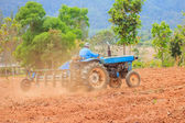 Blue tractor work on the field — Stock Photo