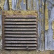 Corroded ventilation hatch on the wooden background with peeled — Stock Photo #62809825