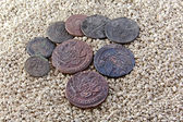 Old copper coins in the sand — Foto de Stock