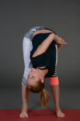 Fit healthy sporty young beautiful woman doing yoga. — Stock Photo