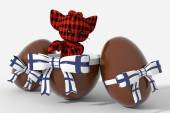 Easter egg chocolate with Finland colors and peluche — Stock Photo