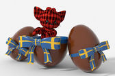 Easter egg chocolate with Sweden colors and peluche — Stock Photo
