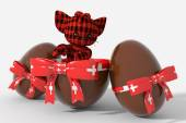 Easter egg chocolate with Switzerland colors and peluche — Stock Photo