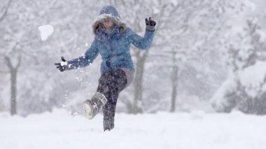 Young Woman Kicking  Snow — Vídeo stock
