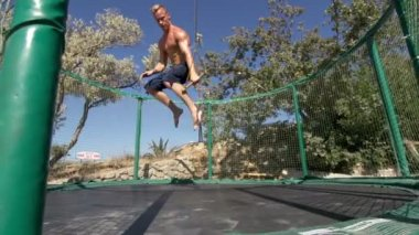 Man Jumping On The Trampoline — Stock Video