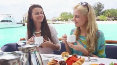 Women Enjoy Morning Coffee On Boat — Stock Video