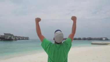 Man Expressing Achievement On Paradise Beach — Stock Video