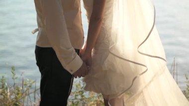 Wedding couple kissing near the ocean — Stock Video