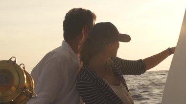 Man And Woman Watch Setting Sun — Stock Video