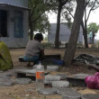 Indian women work outside a fireworks factory — Stock Video #70010543