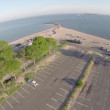 Aerial view of a parking lot on the beach — Stock Video #70012023