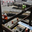 Steelworkers balance on steel support beams at a work site — Stock Video #70016029