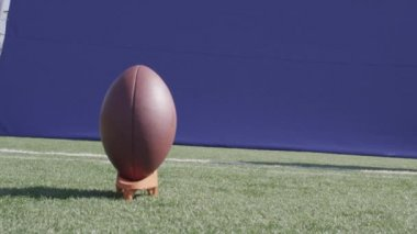 A football is kicked off a tee — Stock Video