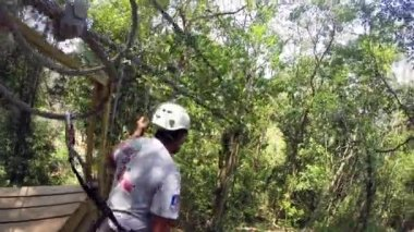Young woman rides zip-line — Stock Video