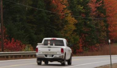 Tilt up from pickup truck driving — Stockvideo