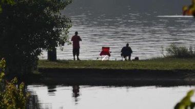 Wide shot of two men fishing — Stock Video