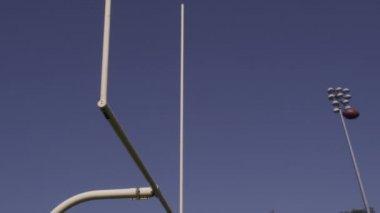 Kicking a football through a field goal post — Stock Video