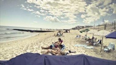 Unidentified people sunbath on the beach, timelapse — Stock Video