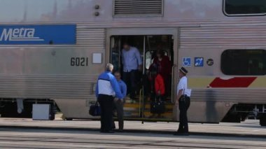Commuters exit a Metra train — Stock Video