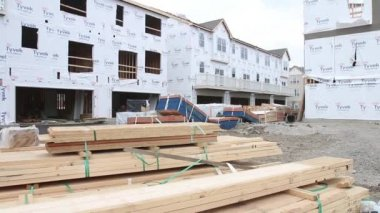 Jib shot of new townhome construction site — Stock Video