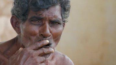 Indian man smokes a cigar — Stock Video