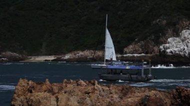 Peroni catamaran and small ferry — Stock Video