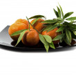 Tangerines on a big black plate — Stock Photo #64304207