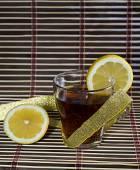 Cup of tea with a lemon wrapped up by a gold tape — Stock Photo