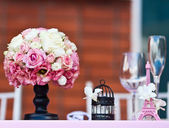 Wedding bouquet on a banquet table — Stock Photo