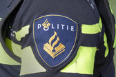 Batch on the uniform of a dutch police officer — Stock Photo
