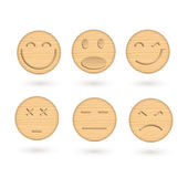 Set of 6 wooden smileys with carved facial features. — Stock Vector