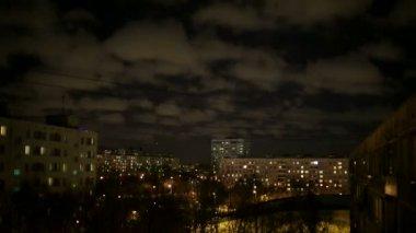 Night sky above the city — Wideo stockowe