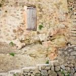 Old sandstone wall in the historic village Deia in Majorca — Stock Photo #66951329