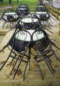 Chairs of a enclosed pub, autumn. Color image — Stock Photo