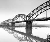 The Gerola iron bridge, over the Po river, Lombardy Province of Pavia. Black and white photo. — Stock Photo