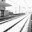 Railroad station in the country, winter landscape with snow. Black and white photo — Stock Photo #64347359