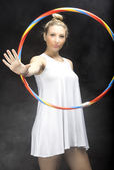 Woman playing with hula hoop — Stock Photo