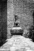 Decorative monument in the shape of lion. Black and white image — Stock Photo