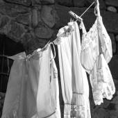 Hanging clothes. Black and white photo — Stock Photo