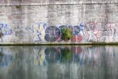 Graffiti along the Milan Navigli. Color image — Stock Photo