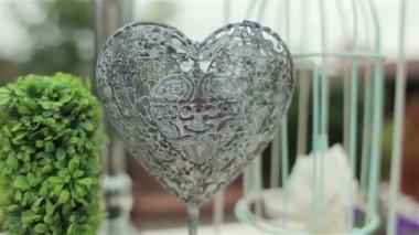 Wedding decoration of wedding ceremony. Iron heart. Camera moves away — Stock Video