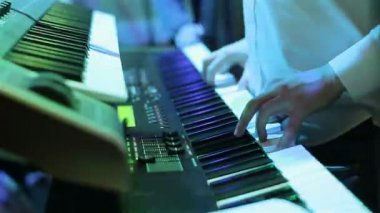 Musician playing keyboard at the party. Close-up. Chaotic camera — Stock Video