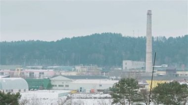 Winter view of old inactive factory not in use with smokestack in the middle. Pan — Stock Video