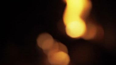 Blurred light effect bokeh of fire place — Stockvideo