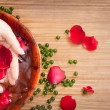 Female Hands in Water with Red Rose and Petals — Stock Photo #65943463