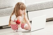 Little Girl Playing with Laptop — Stock Photo